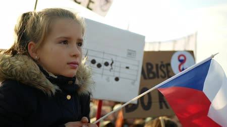 PRAGUE, CZECH REPUBLIC, NOVEMBER 16, 2019: Demonstration of people crowd against Andrej Babis demise, 300,000 mass protesters crowd throng of activists Letna Prague, flag young girl Wideo