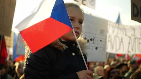 PRAGUE, CZECH REPUBLIC, NOVEMBER 16, 2019: Demonstration of people crowd against Andrej Babis demise, 300,000 mass protesters crowd throng of activists Letna Prague, flags young girl Wideo