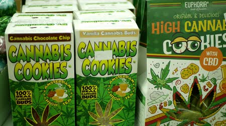PRAGUE, CZECH REPUBLIC, SEPTEMBER 9, 2019: Cannabis cookies buds shop or store Prague, packaged hemp cannabidiol CBD biscuit or cracker seeds and in relieves pain, leaf symbol green, Europe