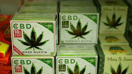 PRAGUE, CZECH REPUBLIC, SEPTEMBER 9, 2019: Cannabis cookies shop store Prague, hash muffin strong, packaged hemp cannabidiol CBD biscuit or cracker seeds and in relieves pain, leaf symbol green