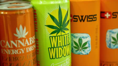 PRAGUE, CZECH REPUBLIC, SEPTEMBER 9, 2019: Cannabis energy drink white widow cans shop or store Prague, packaged hemp cannabidiol CBD seeds in relieves pain, leaf symbol, packaging Wideo