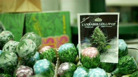 PRAGUE, CZECH REPUBLIC, SEPTEMBER 9, 2019: Cannabis lollipops nicy gel shop or store Prague, packaged hemp sucker cannabidiol CBD seeds in relieves pain, leaf symbol, plastic packaging, sugar Wideo