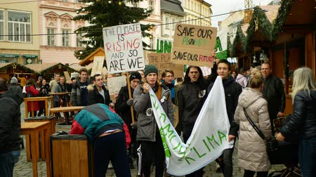 OLOMOUC, CZECH REPUBLIC, NOVEMBER 30, 2019: Activists students, Friday for future, demonstration against climate change, banner sign the climate is rising and thats our planet, people crowd Wideo