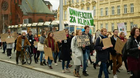 initiator : OLOMOUC, CZECH REPUBLIC, NOVEMBER 30, 2019: Activists students, Friday for future, demonstration against climate change, banner sign the climate is rising and thats our planet, people crowd Stock Footage