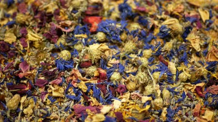 tomilho : Herbal tea dried blend mixture of rose, cornflower, hibiscus, thyme leaf petals and mother-of-tea for high-quality teas as well as decorative. traditional folk medicine, diseases hectic stressful Stock Footage