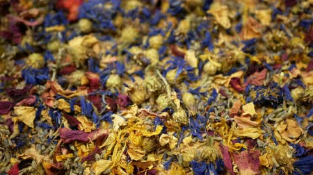 infusion : Herbal tea dried blend mixture of rose, cornflower, hibiscus, thyme leaf petals and mother-of-tea for high-quality teas as well as decorative. traditional folk medicine, diseases hectic stressful Stock Footage
