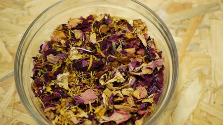 hibiscus tea : Herbal tea dried blend mixture of rose glass jar cup, cornflower, hibiscus, thyme leaf petals and mother-of-tea for teas as well as decorative. traditional folk medicine, diseases hectic stressful Stock Footage