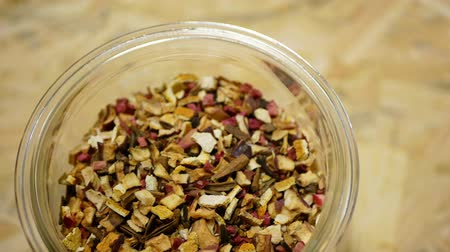 клюква : Herbal tea dried blend of rose glass jar cup, apple, lemon peel, cranberry, orange peel, star anise winter punch, cloves, cinnamon tea well decorative. Traditional folk medicine fruit, human health
