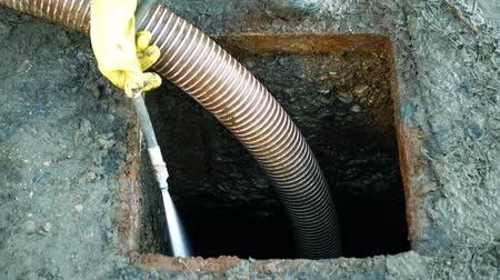 septic : Septic cesspool emptying pumping into pipe tank by suction hose under high pressure. The sump contains pollution sludge sewage water black wastewater and faeces plus excrements from home Stock Footage
