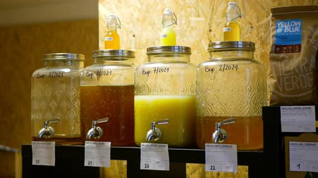 PRAGUE, CZECH REPUBLIC, NOVEMBER 30, 2019: Shop without packaging drugstore modern, healthy wide assortment of liquid soap, washing gel, shampoo hygiene gritter strew on pouring lever glass bottles Wideo