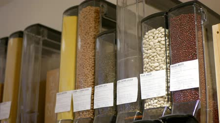 PRAGUE, CZECH REPUBLIC, NOVEMBER 30, 2019: Shop without packaging modern, healthy nutrition wide assortment of cereals, legumes, pasta, sprinkles gritter strew on the pour lever flour glass bottles