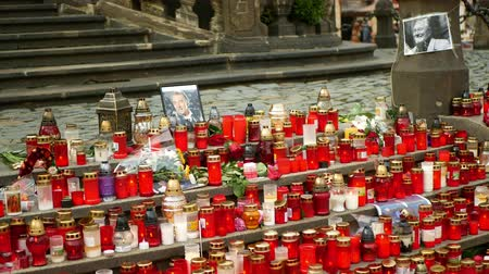 OLOMOUC, CZECH REPUBLIC, OCTOBER 2, 2019: Karel Gott, a singer of popular music of the Czech Republic, died. Commemorative place with candles, photos, roses people light candles of family