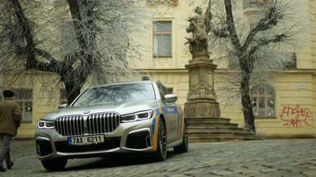 секунды : OLOMOUC, CZECH REPUBLIC, JANUARY 3, 2019: Police car BMW 745Le combines three-liter turbocharged six-cylinder petrol engine with electric motor external rechargeable batteries, hybrid vehicle people