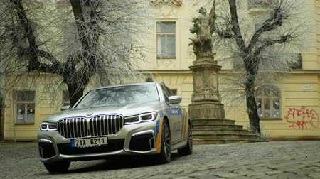 OLOMOUC, CZECH REPUBLIC, JANUARY 3, 2019: Police car BMW 745Le combines three-liter turbocharged six-cylinder petrol engine with electric motor external rechargeable batteries, hybrid vehicle people