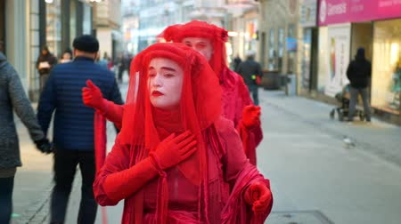 BRNO, CZECH REPUBLIC, JANUARY 10, 2019: Extinction rebellion red brigade pantomime, panto mime activists and activism steps rebels ire demonstration climate change fire bushfires burners Australia