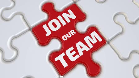 Join our team. The inscription on the red puzzle. Folding white puzzles elements and one red with text: JOIN OUR TEAM. Footage video