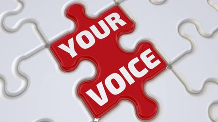 Your voice. Folding white puzzles elements and one red with text: YOUR VOICE. Footage video