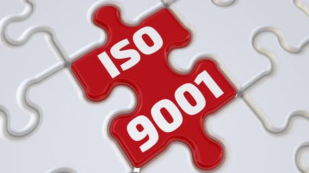 ISO 9001. Folding white puzzles elements and one red with text: ISO 9001. Footage video