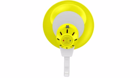tebliğ : Yellow loudspeaker rotates around its axis. Footage video