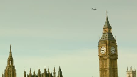 big ben : Plane flies above the Big Ben
