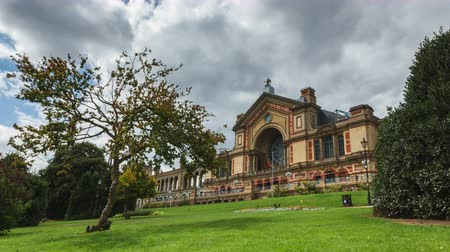 alexandra park : Alexandra Palace in London, Time-Lapse with trees and cloudy weather Stock Footage