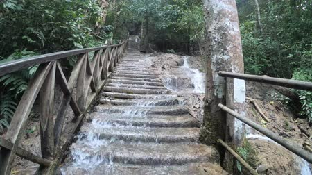 prabang : Water rushing over a staircase trail at Kuang Si waterfalls, Luang Prabang, Laos
