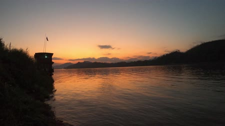 prabang : Docked slow boat by the Mekong river at sunset, Luang Prabang, Laos Stock Footage