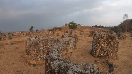 плато : Megalithic landscape at Plain of Jars site 1 during sunset, Phonsavan, Laos