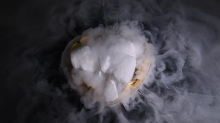 HD video white smoky movement in the heart bowl with effect of dry ice on darkness background