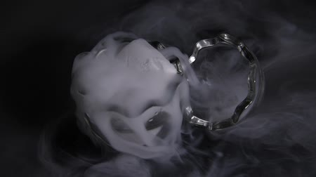 HD video white smoke in egg glass with the effect of dry ice on darkness background Stock Footage