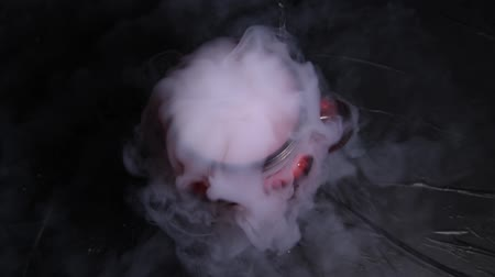 HD video white smoke in red glass with the effect of dry ice on darkness background Stock Footage