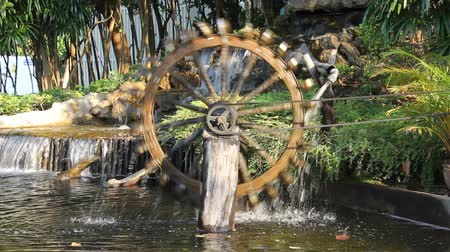 irrigate : waterwheel with artificial waterfall