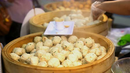bamboo steamer : meat balls steamed with smoke in a bamboo steamer Stock Footage