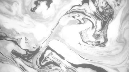 произведение искусства : Abstract paint ink in motion. Psychedelic background footage. Black and white spots.
