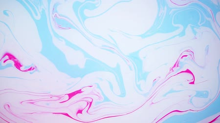 contemplativo : Abstract paint ink in motion. Psychedelic background footage. Colorful spots.