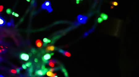 blurred lights : Lights garlands, abstract background. Bokeh effect. Christmas tree lights twinkling. Winter Holidays footage. Stock Footage