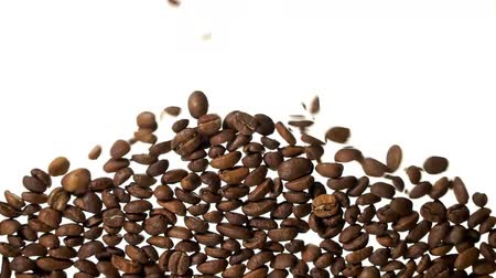 заполнять : Coffee beans falling down on white backgound filling up the screen space.