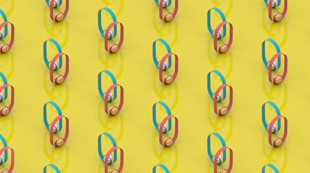 infinito : 3D animation of moving rings on bright yellow background.  3D rendering. Loopable. Stock Footage