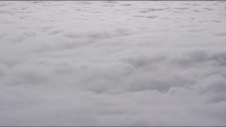 whirling : Clouds forming a swirling surface over the mountains. Time-lapse.