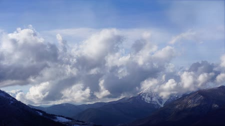 fade in : Clouds flying high over Caucasus mountain landscape fade-in. Can be used for opening credits, titles. Time lapse.