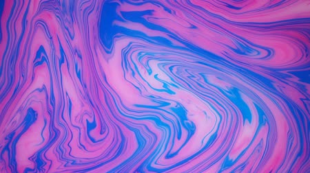 marbling : Stains of ink on the water. Abstract background footage.