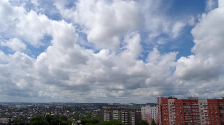 time laps : White clouds running over city, bright blue sky. Timelaps. Stock Footage