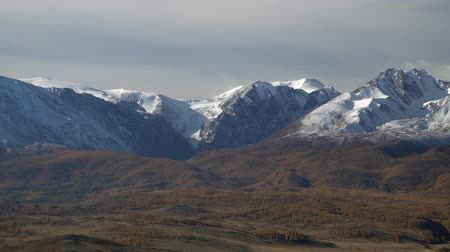 Beautiful panoramic shot of snowy Altai mountains peaks.