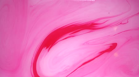ebruli : Stains of pink and white ink on the water. Abstract background footage. Stok Video