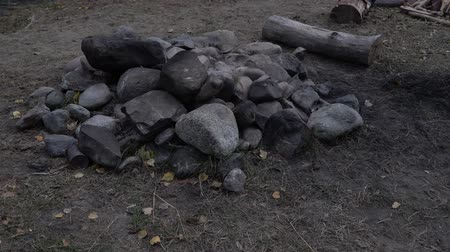 alt : Pile of stones by the camping fireplace. Filmati Stock