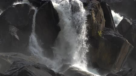 boulders : Powerful cascade waterfall Uchar. Altai mountains, Siberia, Russia. Stock Footage