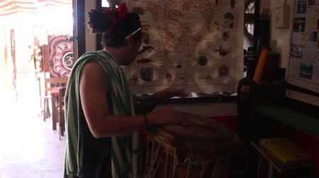 aboriginal : Close up of hands playing Tabla drums while feet dance in the background. Stock Footage