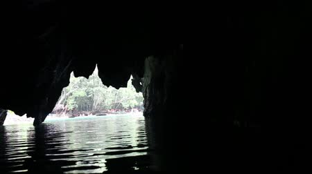 subterranean : Unique image of Puerto Princesa subterranean underground river from inside - Adventurous trip in exclusive Philippines destinations - Dark lighting with the real feeling from visitors point of  view Stock Footage