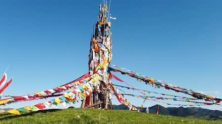 požehnat : buddhism colorful prayer flags symbol of spiritual belief of Tibetan traditional on the mountain with blue sky