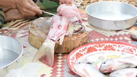 eviscerated : The chef was filleting fish with a knife.